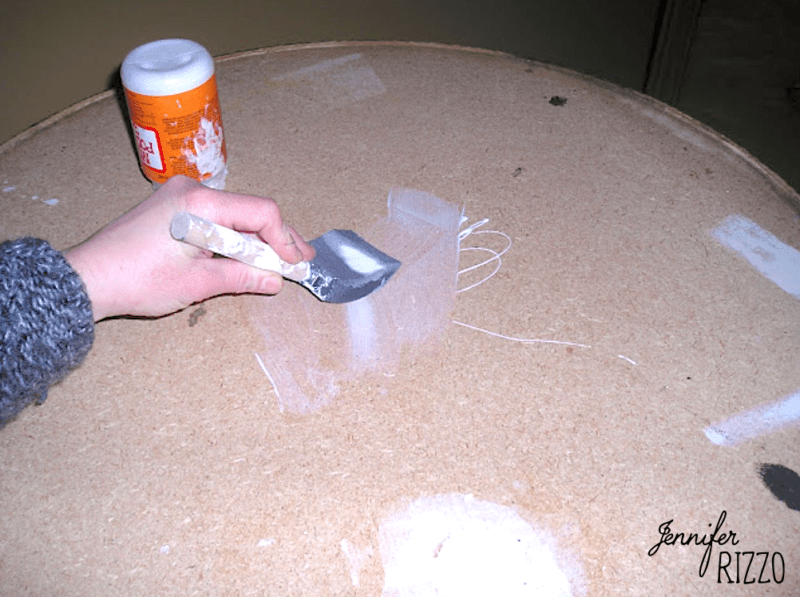 Apply decoupage medium to the top of the table
