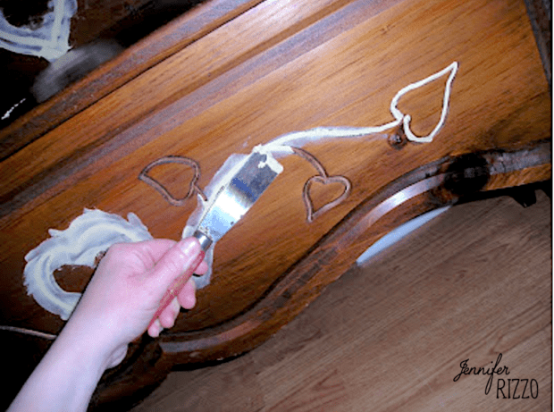 Smoothing wood putty on filling in carved wood areas