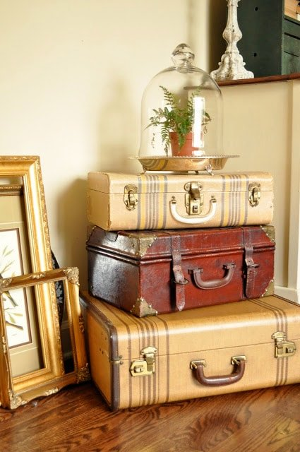 Vintage stacked suitcases with a cloche
