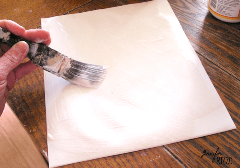 Apply decoupage medium to the back of paper