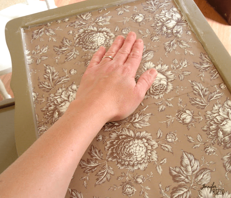 Smooth paper after applying with decouage medium when decoupaging paper onto a table top