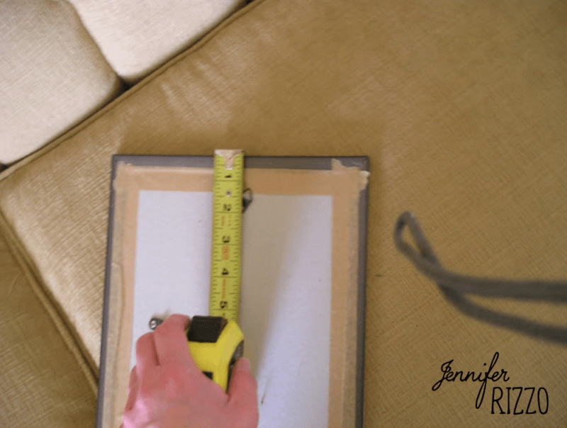 Measure the back of your mirror to hang
