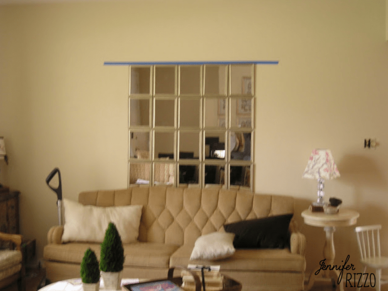 Use dollar store mirrors to create a large mirror