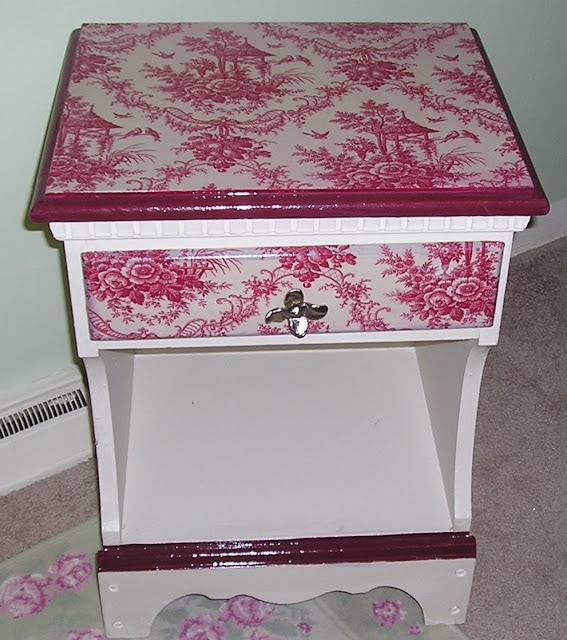 Decoupaged nightstand with fabric