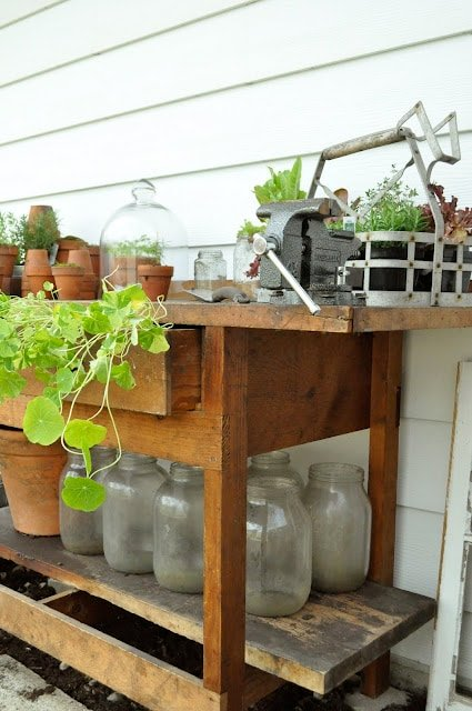 Work bench repurposed as a potting table