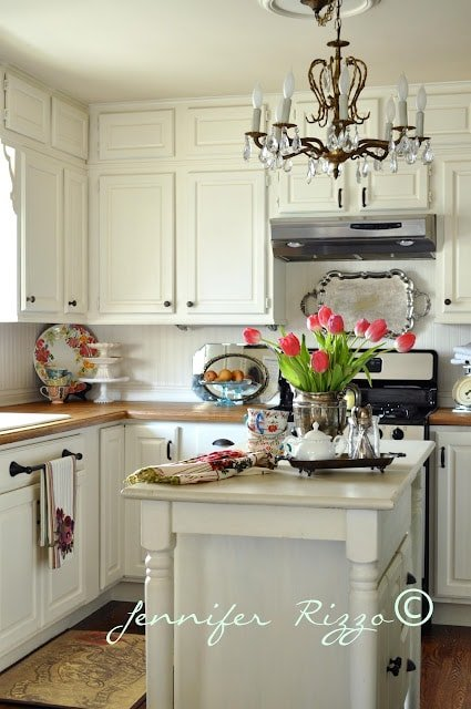 Build a kitchen island with a simple high table and a base cabinet