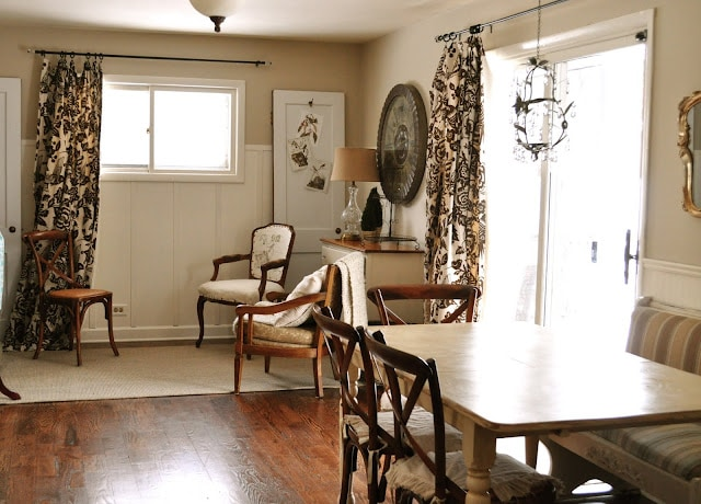 Eat in area with sitting nook and Thomas Paul drapery fabric.