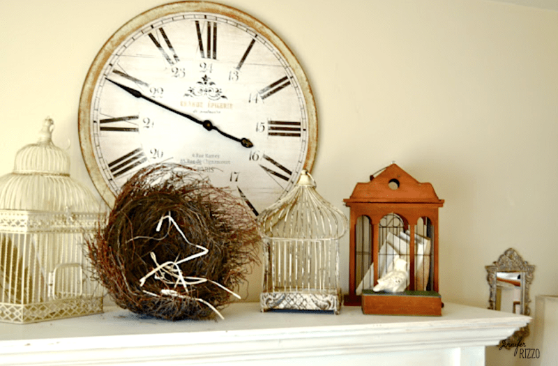 Bird cages on fireplace display