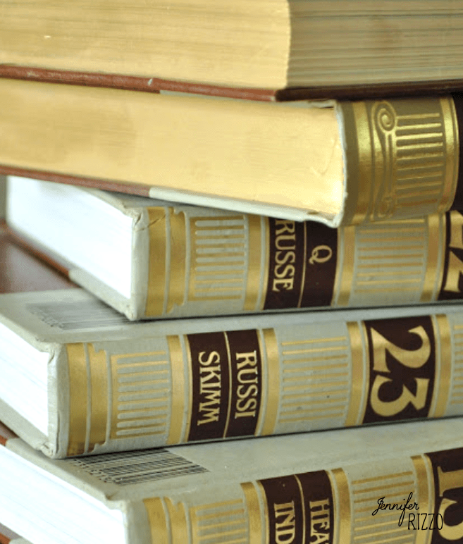 Repurpose old encyclopedias into aged books for display