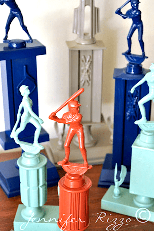 Spray painting old trophies for upcycling