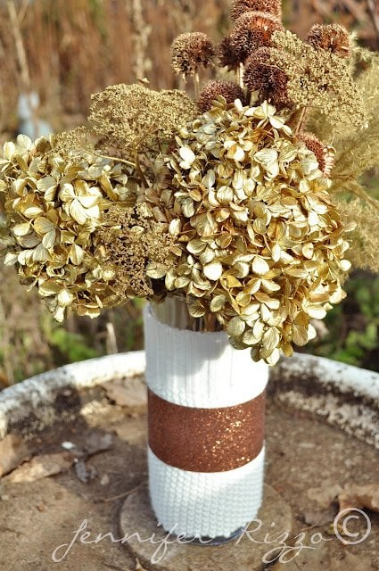 Dried flowers spray painted with gold and copper paint