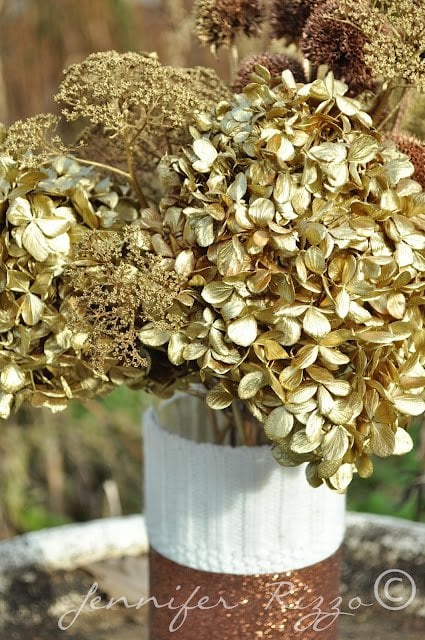 spray painted floral arrangement with gold and copper dried hydrangeas