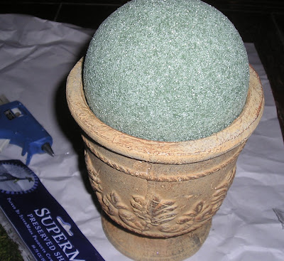 Make a moss topiary