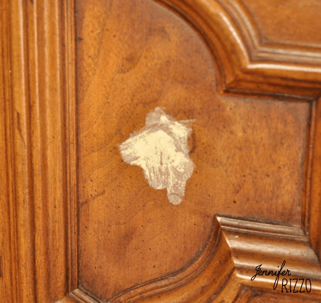 Changing cabinet knob placement with wood putty