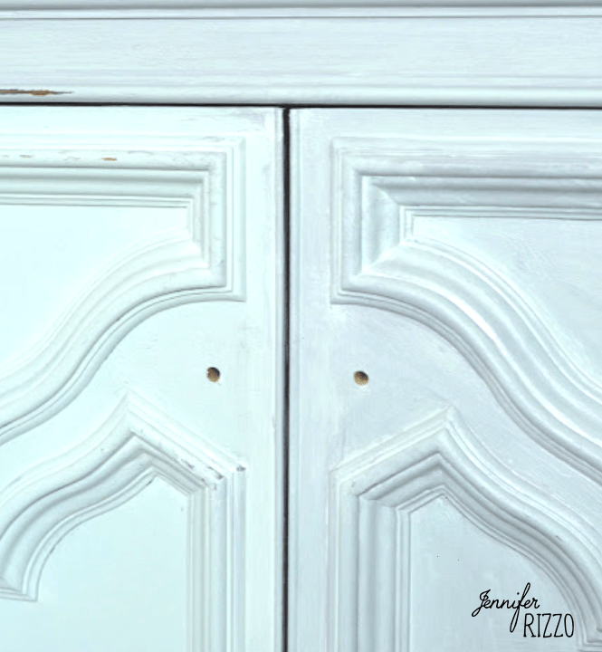 New cabinet knob placement on a painted cabinet