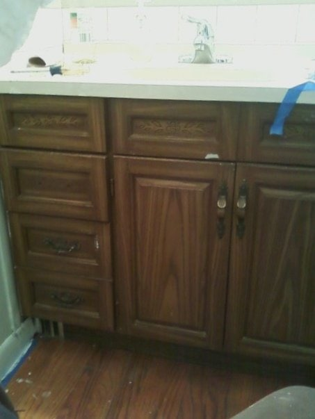 UPdate a dated cabinet witd paint and handles