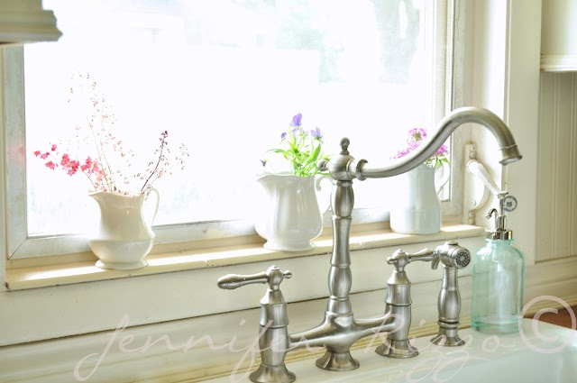 Pretty vintage pitchers on a windowsill