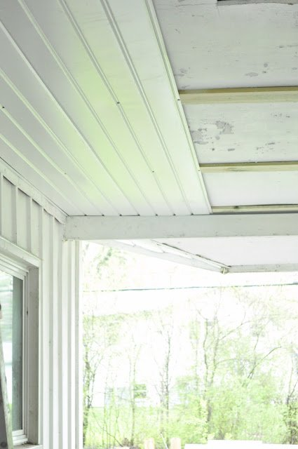 Porch transformation at the Oak house project ceiling updated with metal