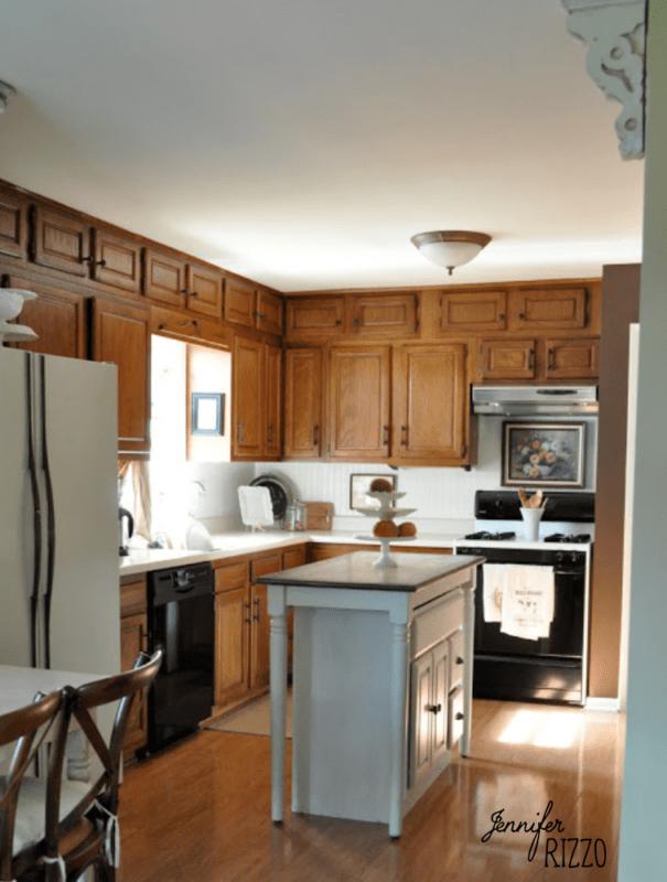 Dark oak kitchen cabinets before painting