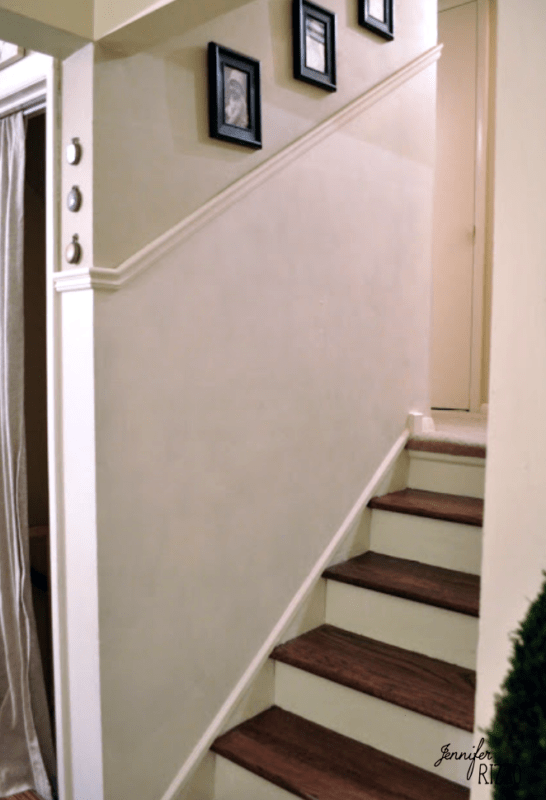 Hallway with added trim and darks tained stairs