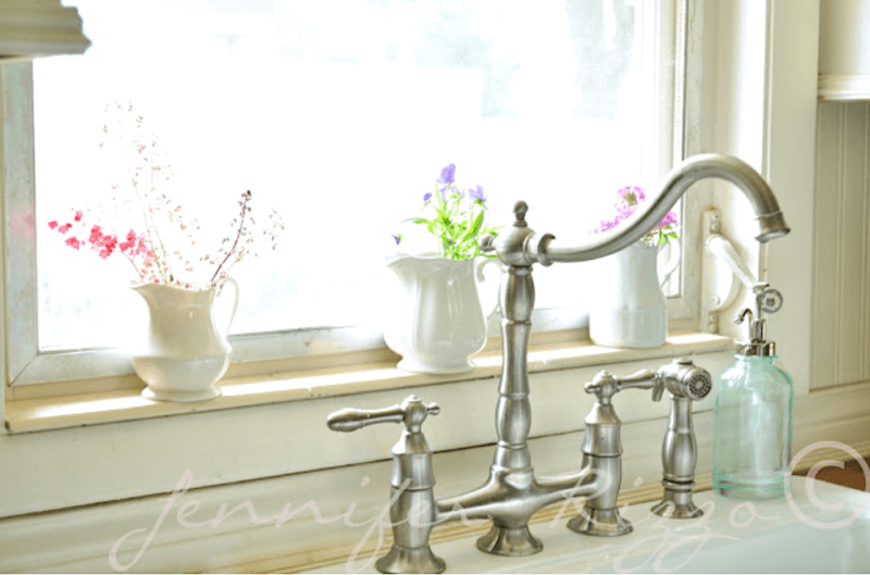 Kitchen sink with stainless steel faucet