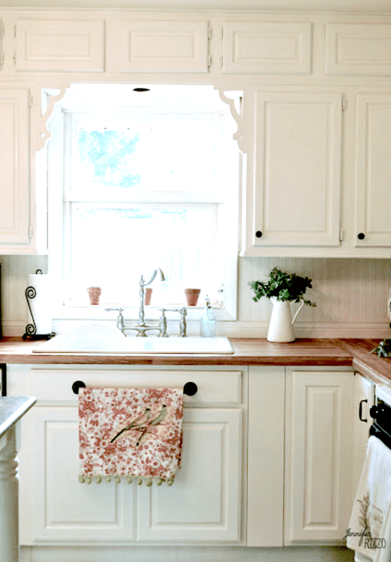 White cabinets with wood countertops