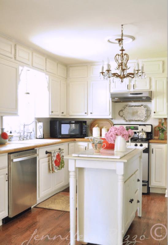 White kitchen island and white cabinets