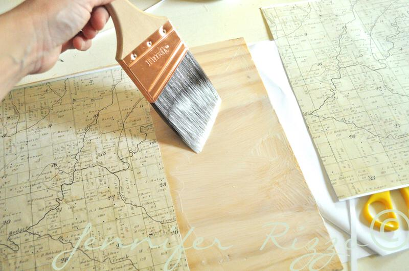decoupage vintage map onto wood to make a mixed media art background in a deer silhouette