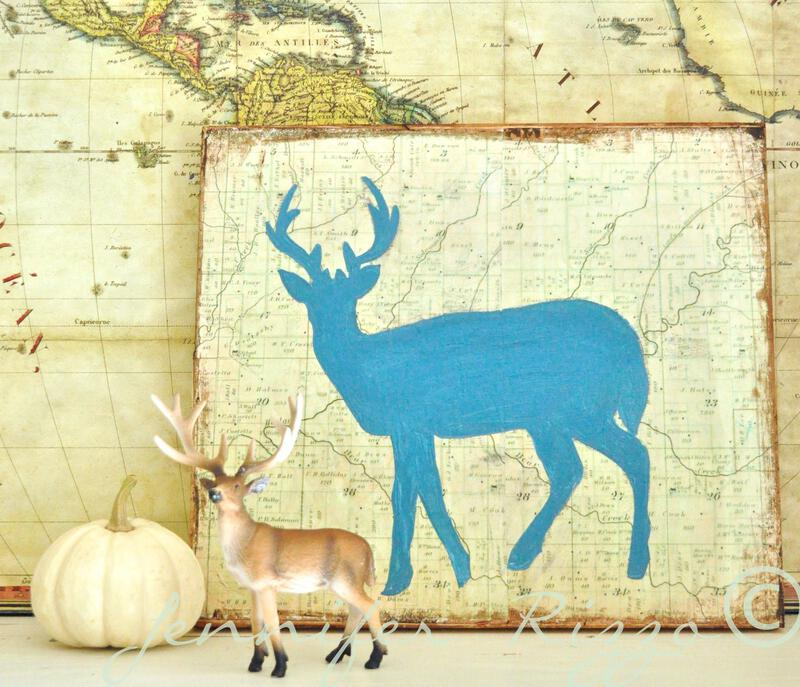 Paint a deer silhouette on a vintage map