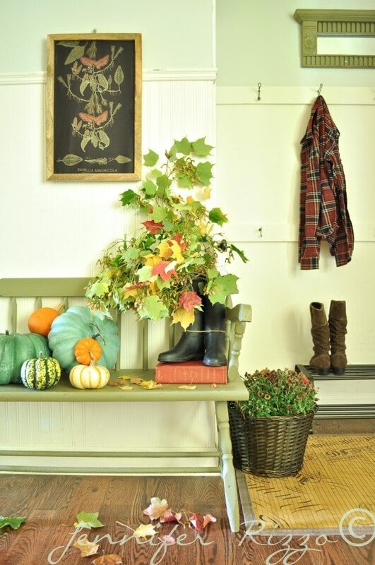 Front entry way with pumpkins and boots with branches in them for free fall decorating