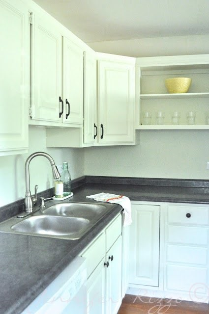 mix new cabinets woth old ones and paint for a cohesive look