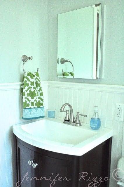 full bathroom renovation with a dark vanity  and moen faucets Pretty bathroom update