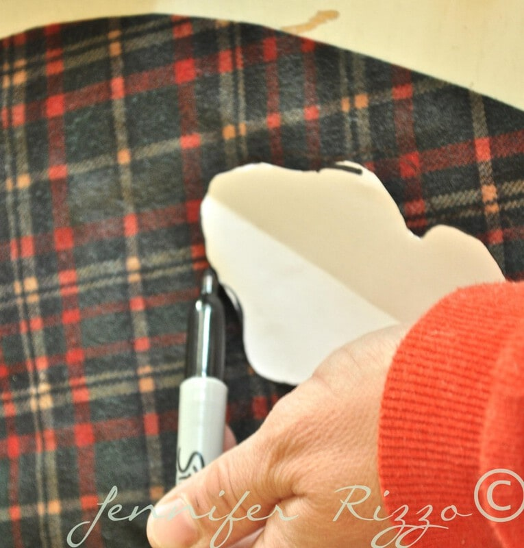 Tracing leaf shapes on an old plaid shirt