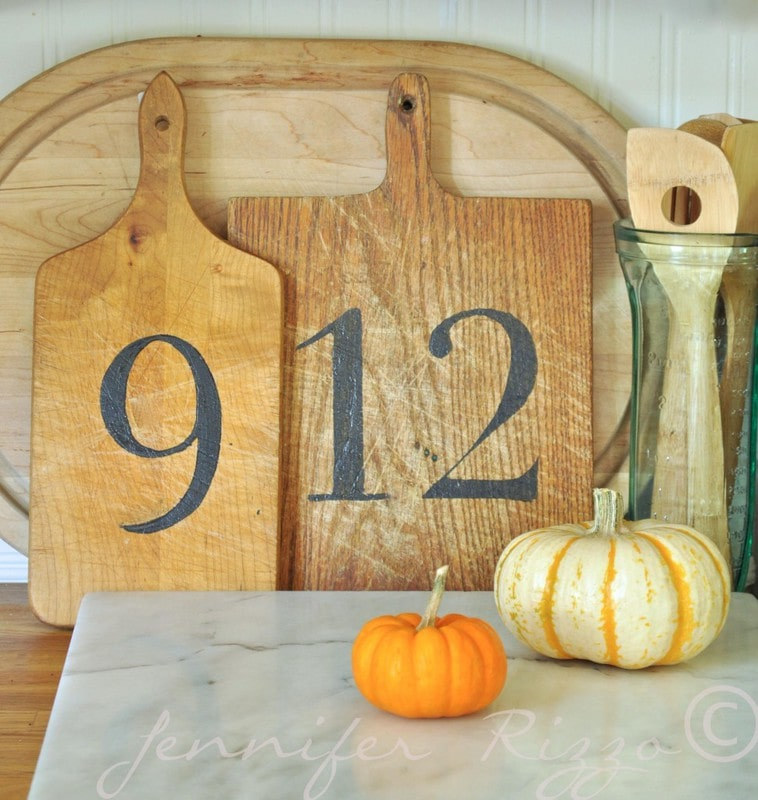 Vintage wood cutting boards with numbers stenciled on them