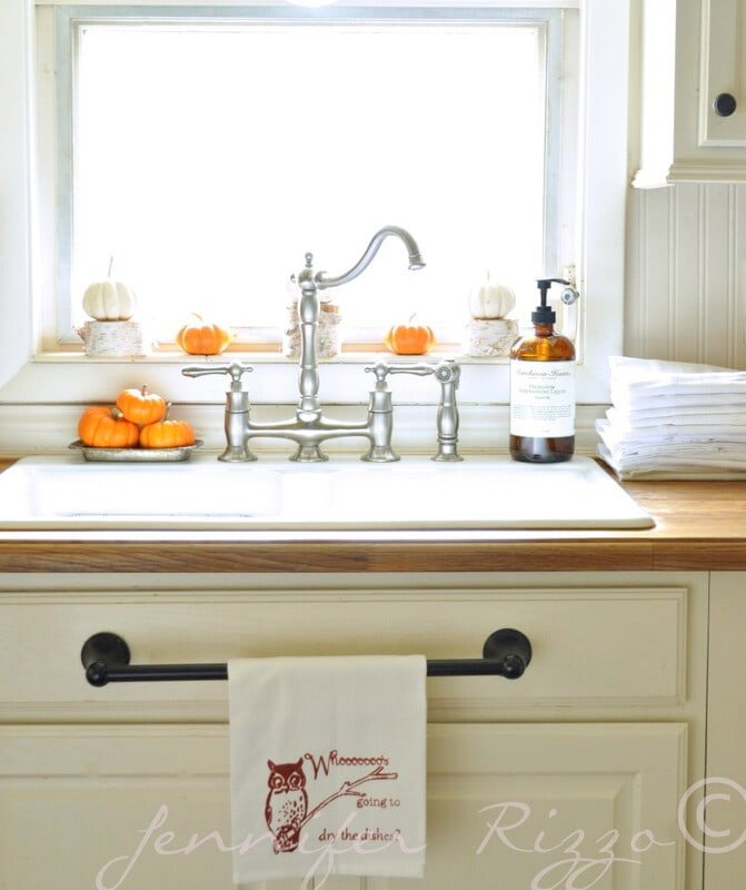 Fall kitchen sink with pumpkins as decor