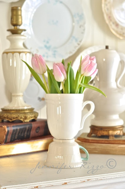 Use vintage and thrift store tea cups to make a fun upcycled vase