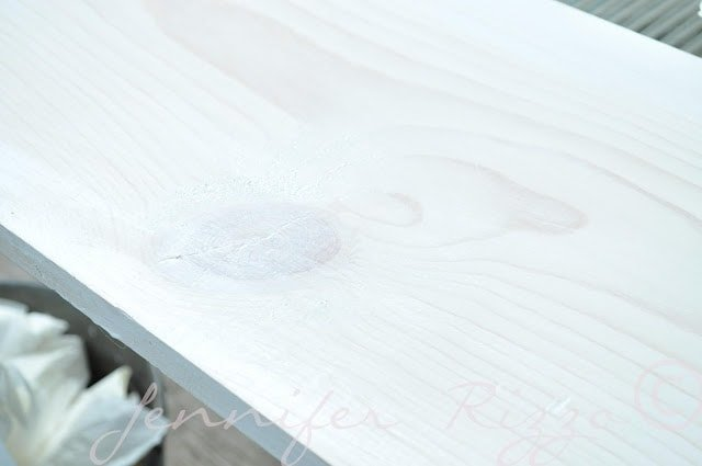 Pickle bare wood by rubbing cream or white aryclic paint into it.