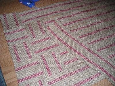 Make an inexpensive upholstery webbing rug…..
