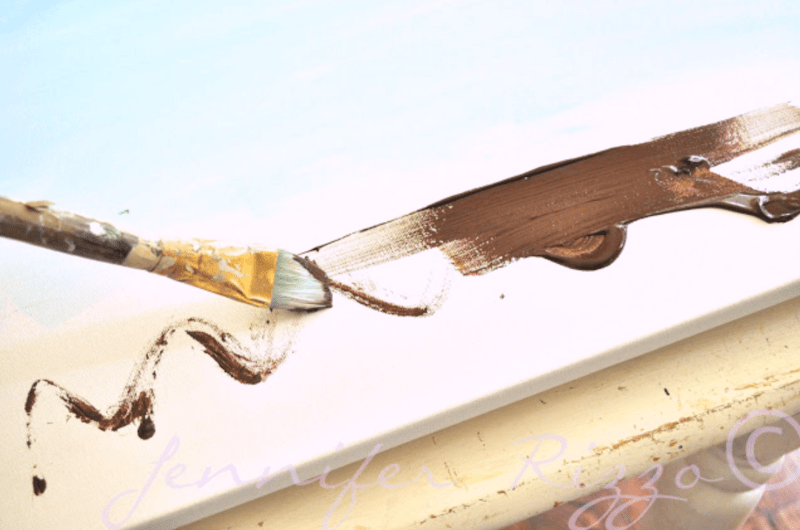 Painting the base of a painting on a canvas
