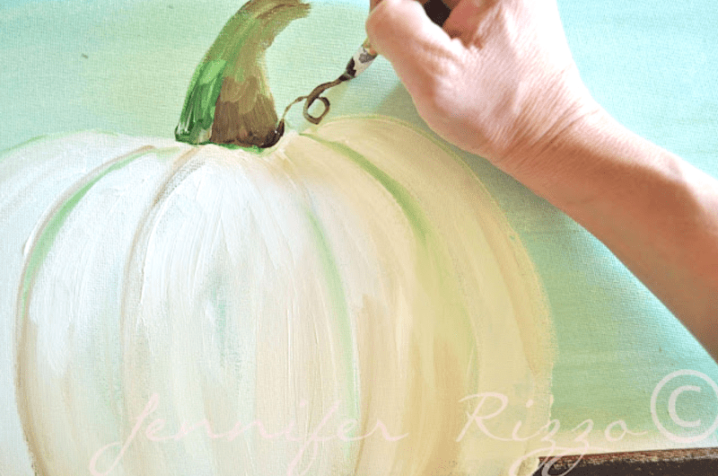 Use brown paint to add a curlicue on the pumpkin