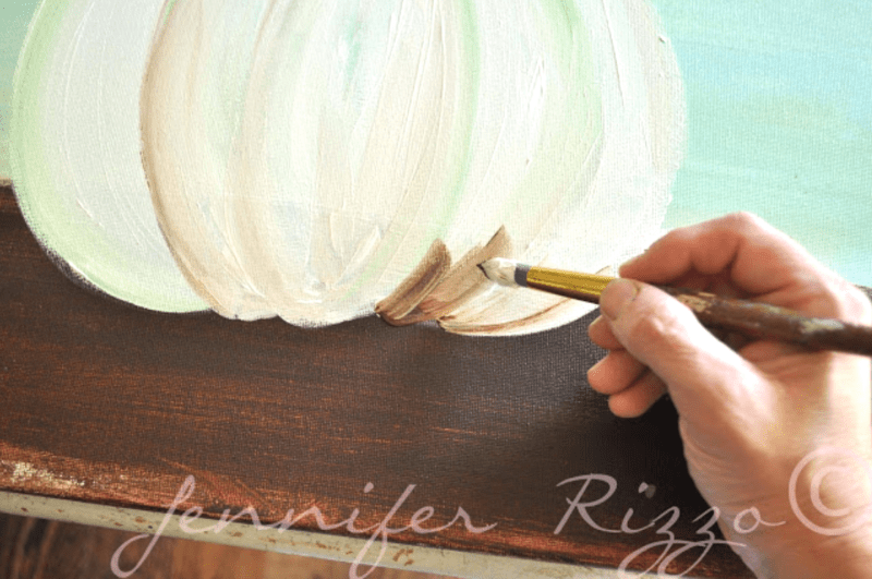 Use burnt umber paint to add a shodow under the pumpkin