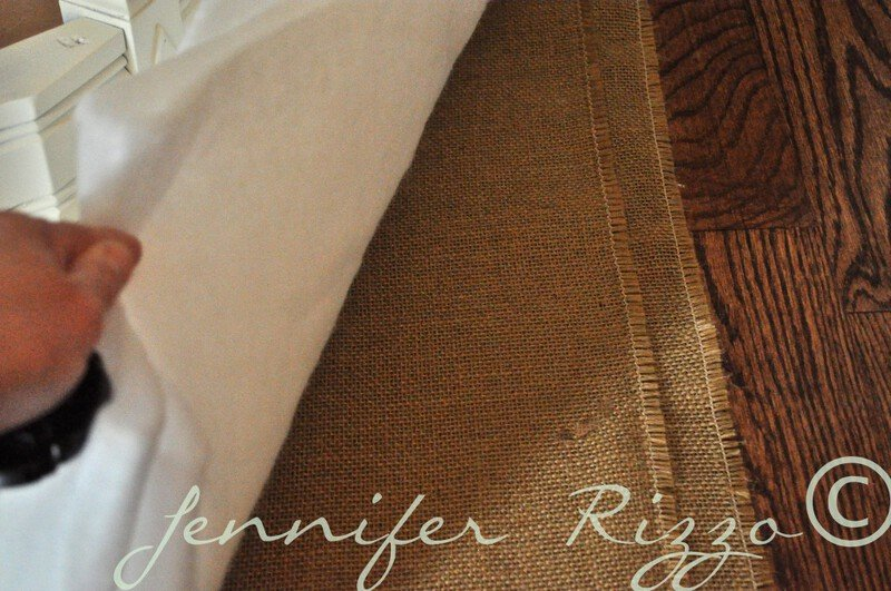 layer burlap and padding for a tufted ottoman