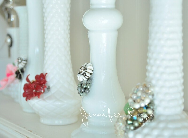 Use broekn vintage jewelry on old milk glass vases as a pretty upcycle idea
