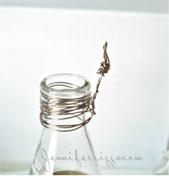 Make a wire hanger on a flask neck
