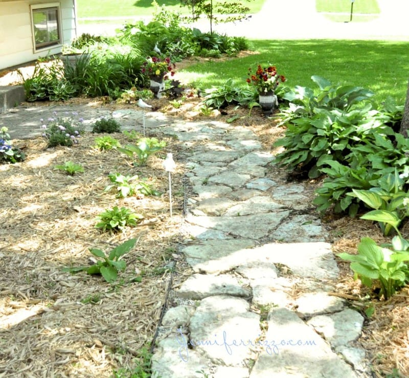 Front landscaped walk with flagstone path