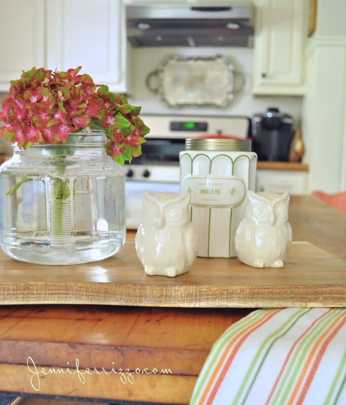 storage jar used as a vase for flowers