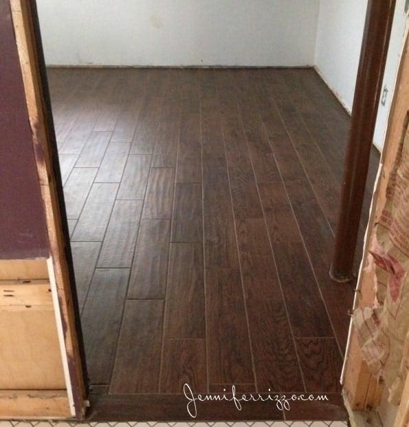 Wood look ceramic tile in basement
