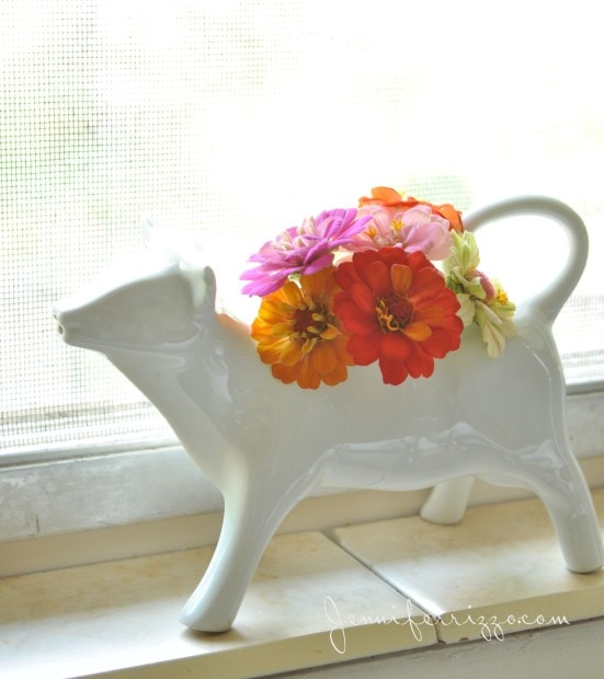 cow creamer used as a vase