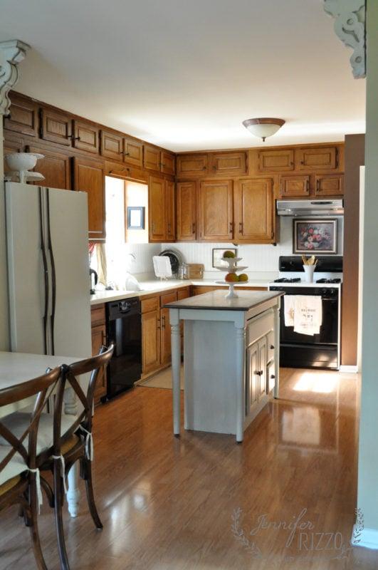 Dark oak cabinets before painting