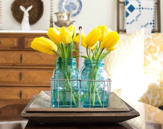 Pretty yellow tulips in vintage blue mason jars